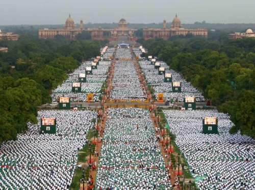 "In this handout photograph released by the Press Information Bureau (PIB) on June 21, 2015, thousands of participants perform yoga on Rajpath in New Delhi. Prime Minister Narendra Modi hailed the first International Yoga Day as a ""new era of peace"", moments before he surprised thousands in New Delhi by taking to a mat himself to celebrate the ancient Indian practice.  AFP PHOTO/PIB/VIJAY KUMAR  ----EDITORS NOTE---- RESTRICTED TO EDITORIAL USE - MANDATORY CREDIT  - ""AFP PHOTO/PIB/VIJAY KUMAR  "" - NO MARKETING NO ADVERTISING CAMPAIGNS - DISTRIBUTED AS A SERVICE TO CLIENTS-----------"