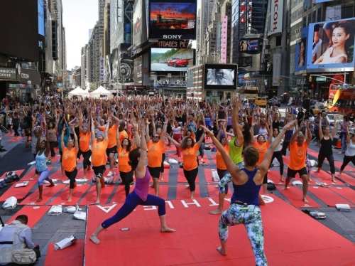 Several hundred yogis practice yoga during the 13th annual Solstice in Times Square event, Sunday, June 21, 2015, in New York. The event drew several thousand people to mark the summer solstice. (AP Photo/Julie Jacobson) /NYJJ106/668396776190/1506212055
